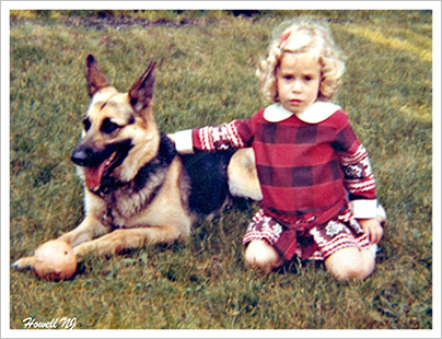 Owner, Beth Ramsey as a little girl with her dog