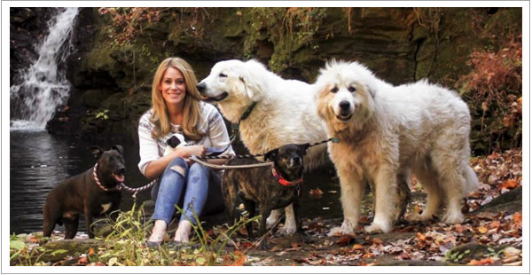 Owner of Serenity Dog Retreat, Beth Ramsey in her college years sitting with her five dogs